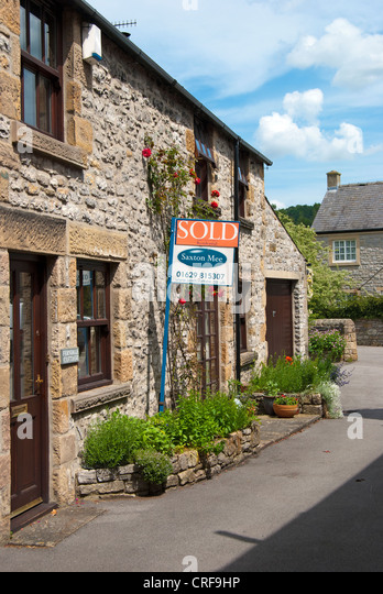Derbyshire Cottage with Sold sign - Stock Image