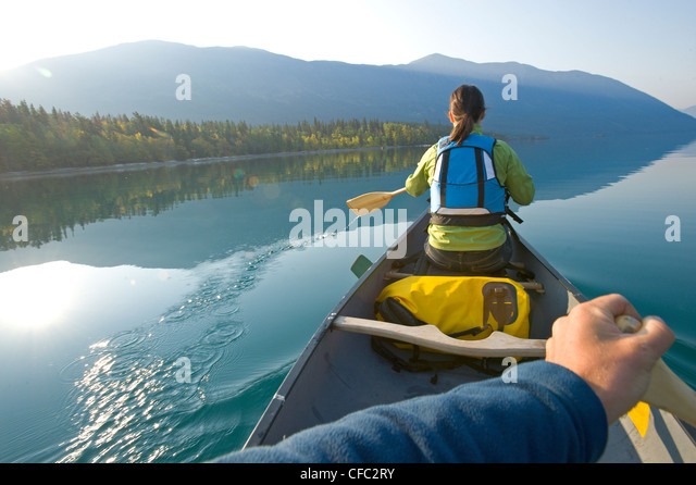 Paddling a canoe on an autumn morning on Chilko Lake, British Columbia - Stock Image