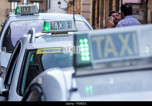 Spain Europe Spanish Hispanic Toledo taxi cab taxis cabs Hispanic man driver - Stock Image