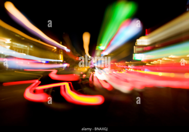 Abstract image of motion-blurred traffic lights in the streets of Las Vegas - Stock Image