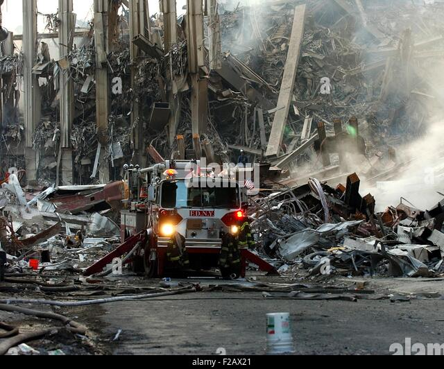 Fire engine by the ruins of the South Tower on Sept 16, 2001. World Trade Center, New York City, after September - Stock-Bilder