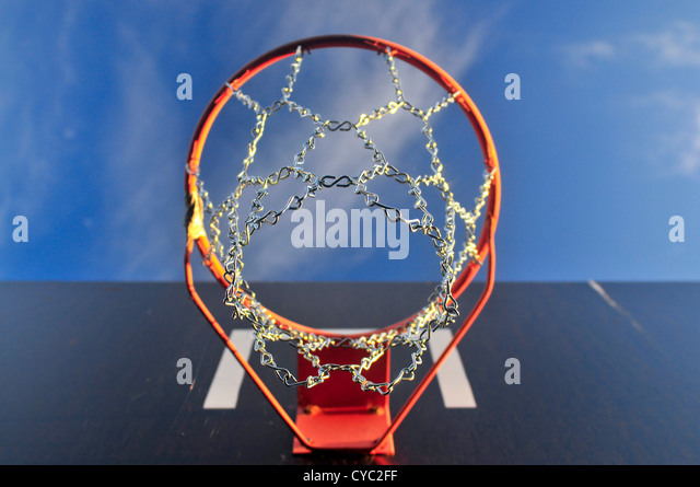 Basketball ring outside with sky and cloud - Stock Image