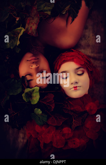 Young boy girl sleeping conceptual surreal - Stock Image