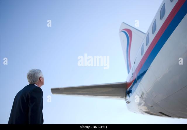 Pilot looking at an plane - Stock Image