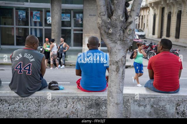 men sitting on the streets of old havana,cuba - Stock-Bilder