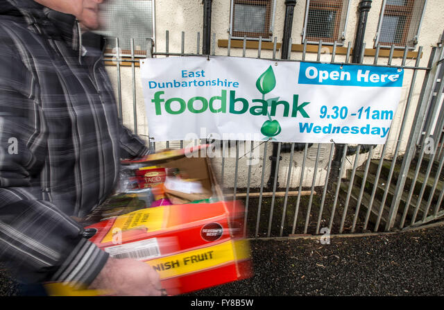 someone leaving foodbank with supplies - Stock Image