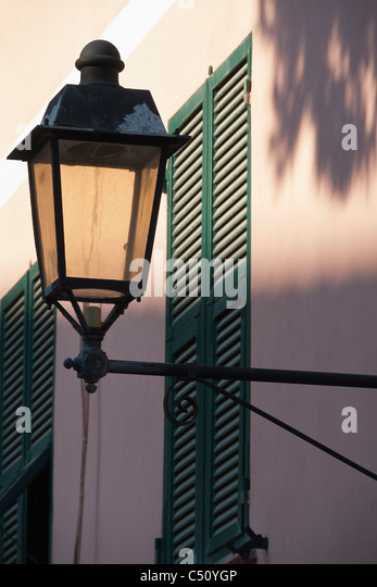 Traditional street lamp attached to a building in Monterosso, Italy. - Stock Image