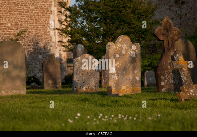 Old headstones in church graveyard - Stock Image