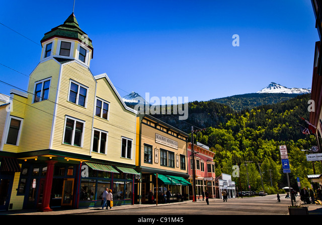Tourists in historic downtown Skagway on a sunny day, Southeast Alaska, Summer - Stock Image