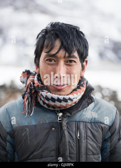 Man makes his way through Nepal's Everest Base Camp - Stock Image