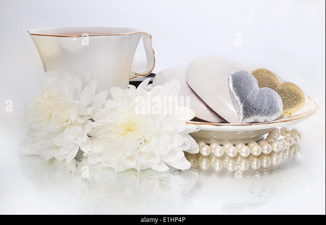 Saint valentines day - pearls, symbols of hearts and white flowers on white background - series of photos - Stock Image