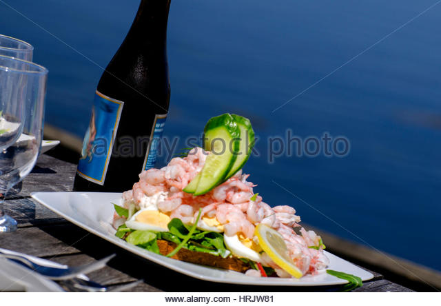 Shrimp sandwich.Gourmet food of a shrimp and egg sandwich with the slice of lemon. Lettuce,cucumbers,and mayonnaise. - Stock Image