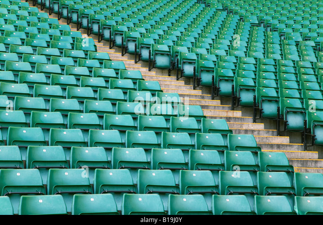 Rows of empty seats in a sports stadium - Stock Image