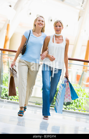 Two women at a shopping mall - Stock Image