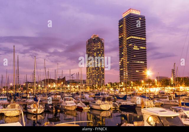 Mapfre tower and Hotel Arts at twilight,  Marina, Barcelona, Catalonia, Spain - Stock Image
