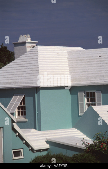 Bermuda Architecture White ribbed Roof Chimney to conserve collect water Green House Blue Sky - Stock Image