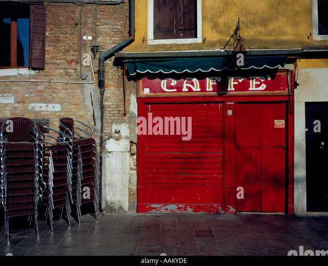 red closed restaurant door at Campo di Margherita, Venice, UNESCO World Heritage Site,  Italy, Europe. Photo by - Stock Image