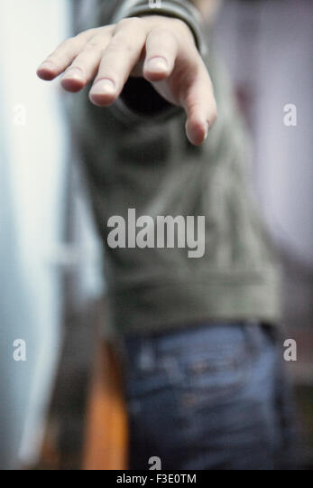 Woman gesturing angrily as she walks away - Stock Image