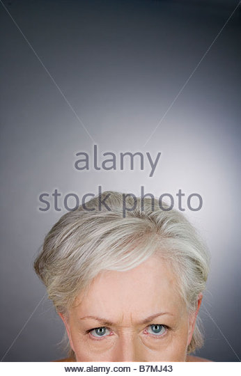 A senior woman looking angry - Stock Image