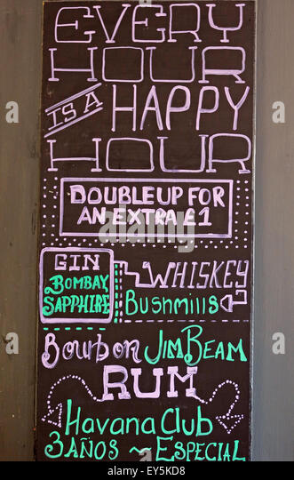 Happy hour drinks,double up for extra £1 sign in a British pub - Stock Image