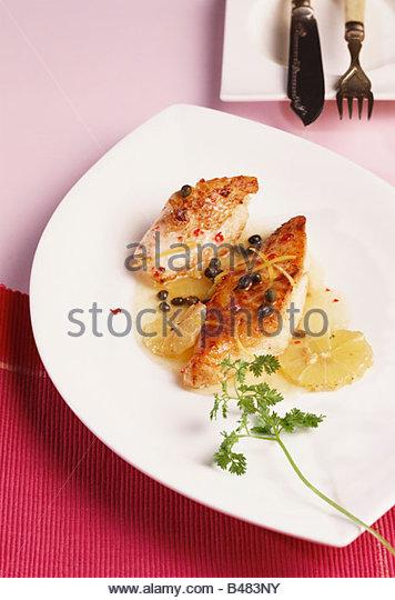 Fish fillet with lemon - Stock-Bilder