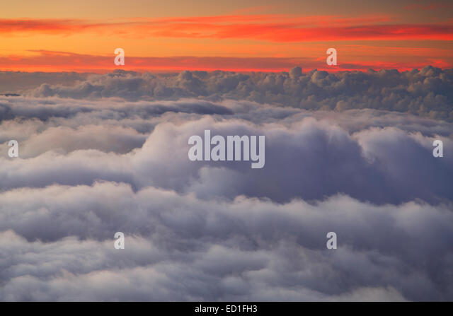 Clouds at sunset from near the top of Haleakala, Haleakala National Park, Maui, Hawaii. - Stock Image