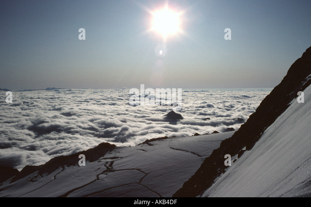 Cloud sea over Italy, from the Hohe Wilde, Ötztal Alps, Austria - Stock Image