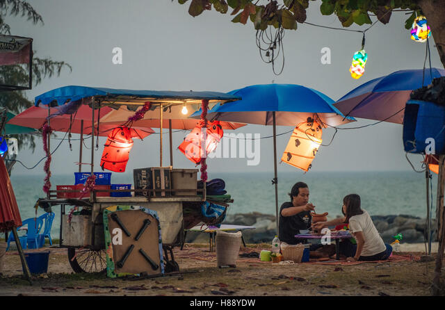 Thai people enjoy a dinner on the beach in Rayong Thailand - Stock Image