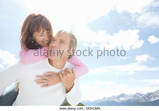 Loving couple having fun outdoors - Stock Image