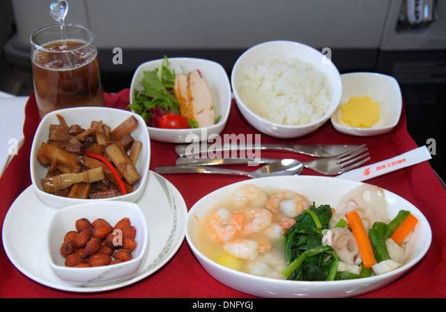 China Beijing Beijing Capital International Airport PEK Air China onboard cabin business class inflight meal lunch - Stock Image