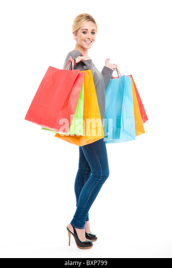 Attractive Young Blond Woman Carrying Lots of Multi-Colored Shopping Bags Looking Happy and Excited - Stock Image