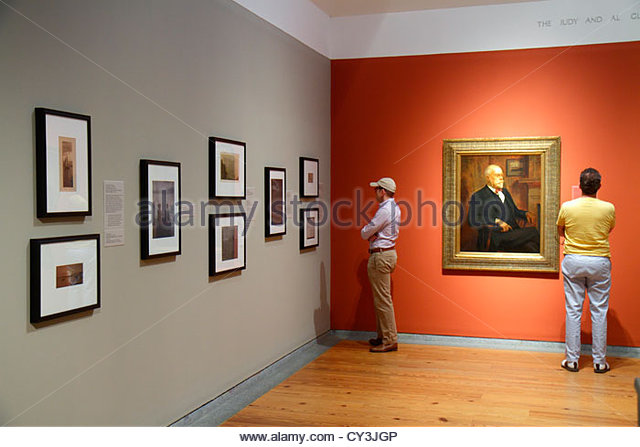 Portland Maine Congress Square Portland Museum of Art man looking at collection painting framed - Stock Image