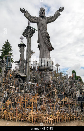 The Hill of Crosses - a site of pilgrimage in northern Lithuania. Over the generations, crosses, crucifixes, statues - Stock Image