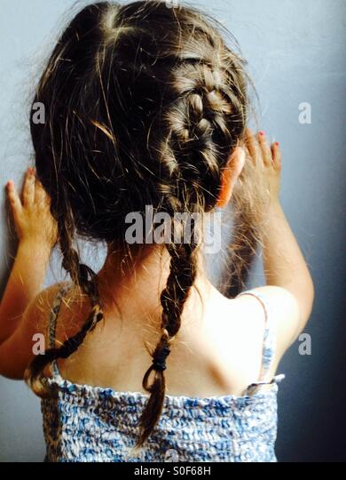 Pigtails on a 3-year old girl - Stock-Bilder