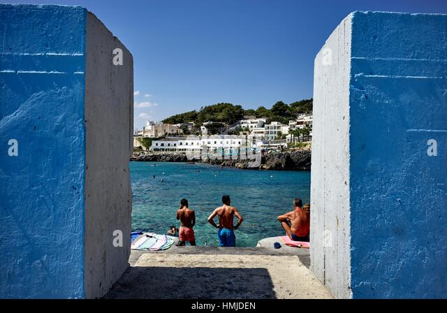 Sun bathing at summer time in Castro, Apulia, Italy - Stock Image