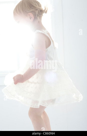 Little girl in white dress - Stock Image