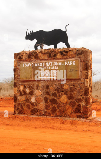 Sign with Rhino at the entrance to the Tsavo West National Park, Kenya, Africa - Stock Image