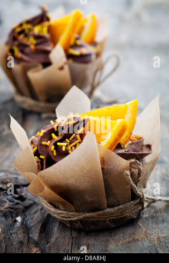 Fresh homemade cupcakes with orange and chocolate - Stock Image