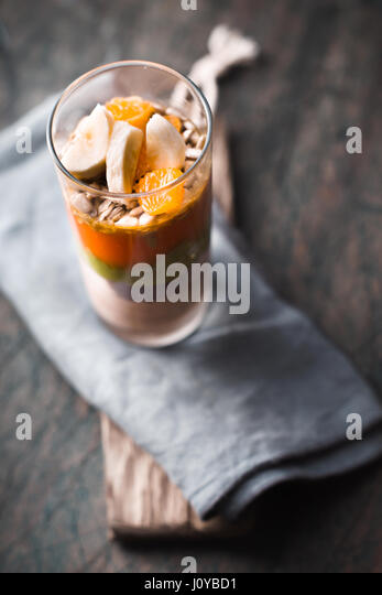 Fruit and yogurt dessert  on the blurred background vertical - Stock Image