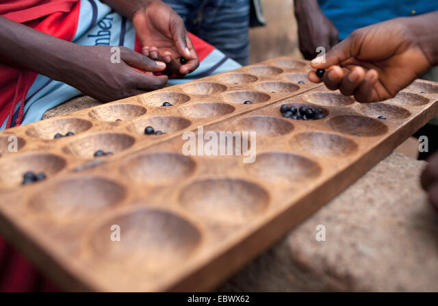 two fishermen playing a traditional board games after work similar to 'draughts', Burundi, Nyanza Lac, Mvugo, - Stock Image