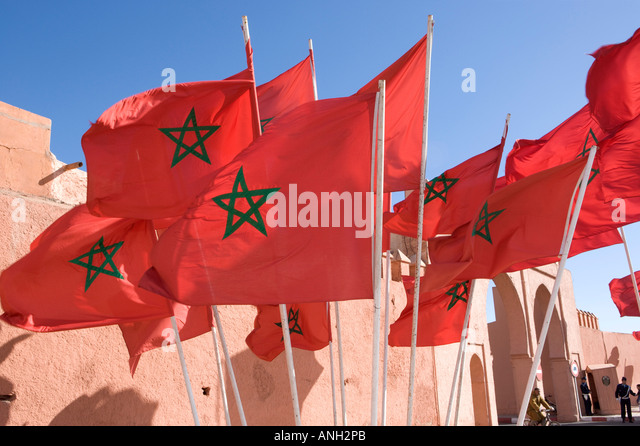 Moroccan flags flying by the city walls, Marrakesh, Morocco - Stock-Bilder