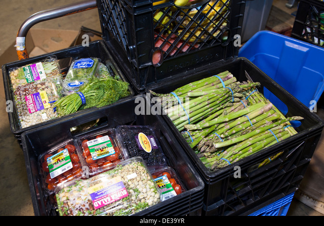 Donated vegetables at food bank - USA - Stock Image
