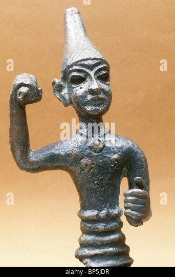 3787. BRONZE FIGURINE OF OF MALE DEITY, PROBABLY THE CNAANITE GOD OF WAR BAAL, DATING CA. 1400 - 1300 B.C. - Stock Image