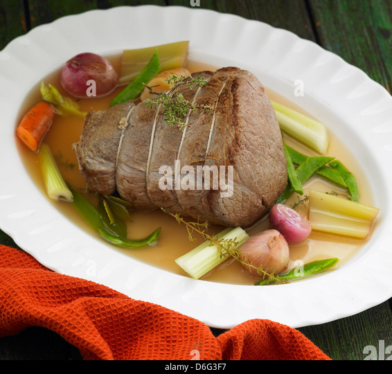 Beef joint with vegetables - Stock Image