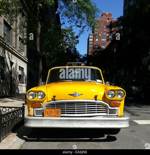 Yellow cab parked on the street, Manhattan, New York, America, USA - Stock Image