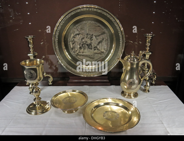 Silverware,Goldware plate and trays at Dunham Massey house NT property, Altrincham, Greater Manchester, England, - Stock Image