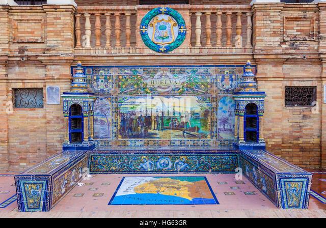 Glazed tiles bench of spanish province of Huelva at Plaza de Espana, Seville, Spain - Stock Image