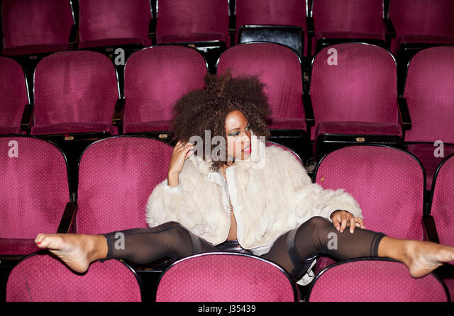 Portrait of a young woman in a theater - Stock Image