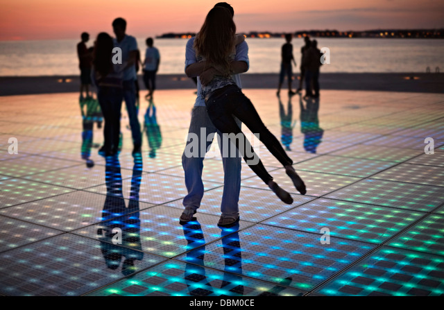Croatia, Dalmatia, Solar panels as a dance floor, sunset in background - Stock Image