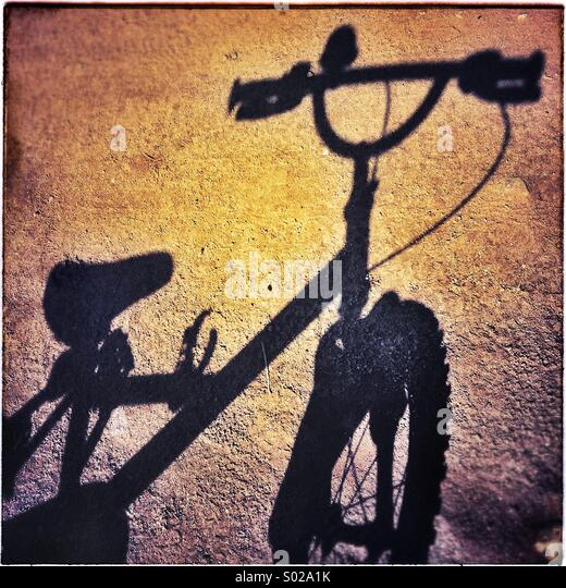 Bicycle shadow on sunday morning - Stock-Bilder